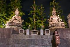 Budas assentadas no templo de Senso-ji Imagem de Stock