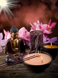 Buddah with candle and incense. Buddha with candle and incense with blur effect royalty free stock photography