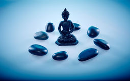 Buddah in a circle of zen stones. Wellness and Spa Image, works perfect for advertising Health and Beauty, Spirituality or Massage Royalty Free Stock Image