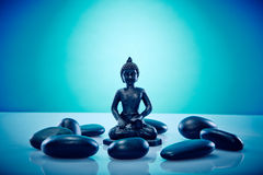 Buddah in a circle of zen stones. Wellness and Spa Image, works perfect for advertising Health and Beauty, Spirituality or Massage Stock Photography