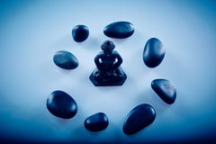 Buddah in a circle of zen stones. Wellness and Spa Image, works perfect for advertising Health and Beauty, Spirituality or Massage Royalty Free Stock Photography