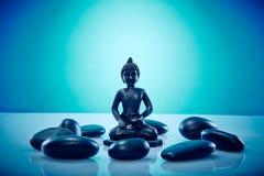 Buddah en cercle des pierres de zen Photographie stock