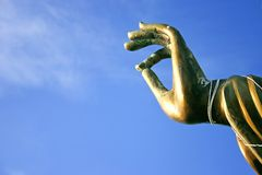 Buddah hand statue. Hand of big buddah in blue sky Royalty Free Stock Photo