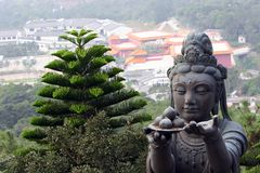 Buddah Hands. Buddhist statue, Hong Kong Island, Look closer and you can see the coins people have thrown into the statues hand royalty free stock photos