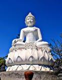 Buddah on a Hill. Peace-inspiring statue of Buddah overlooking Bali stock photo