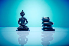 Buddah with hot stones. Wellness and Spa Image, works perfect for advertising Health and Beauty, Spirituality or Massage Royalty Free Stock Photos
