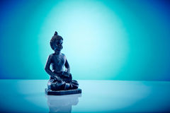 Buddah in lotus pose. Wellness and Spa Image, works perfect for advertising Health and Beauty, Spirituality or Massage Stock Image