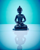 Buddah in lotus pose. Wellness and Spa Image, works perfect for advertising Health and Beauty, Spirituality or Massage Stock Photo