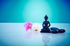 Buddah with pink and white orchis. Wellness and Spa Image, works perfect for advertising Health and Beauty, Spirituality or Massage Stock Photo