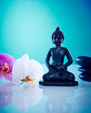 Buddah with pink and white orchis. Wellness and Spa Image, works perfect for advertising Health and Beauty, Spirituality or Massage Stock Image