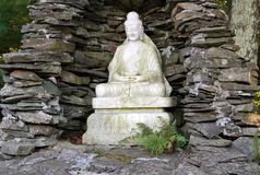 Buddah Statue in Stone Grotto Stock Photography