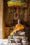 Buddah statue and unbrella. Bayon temple, Ankor, Siem Reap, Cambodia royalty free stock photos