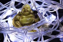 Buddah in un nido delle luci leggiadramente Fotografia Stock