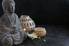 Buddah witn candle spa concept. Buddah witn candle on dark ground spa concept Stock Photos