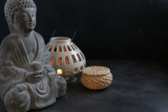 Buddah witn candle spa concept. Buddah witn candle on dark ground spa concept Stock Photography