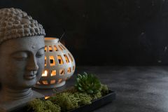 Buddah witn candle spa concept. Buddah witn candle on dark ground spa concept Stock Photo