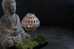 Buddah witn candle spa concept. Buddah witn candle on dark ground spa concept Royalty Free Stock Photos