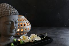 Buddah witn candle spa concept. Buddah witn candle on dark ground spa concept Stock Image