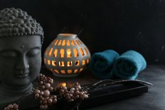 Buddah witn candle and towel spa concept. Buddah witn one candle and towel spa concept Royalty Free Stock Photo