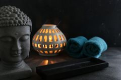 Buddah witn candle and towel spa concept. Buddah witn one candle and towel spa concept Royalty Free Stock Image