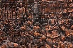 Buddaha history on wall Royalty Free Stock Image