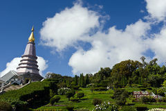 Buddha's relic on Inthanon mountain with garden view in the front and cloudy sky Stock Photo