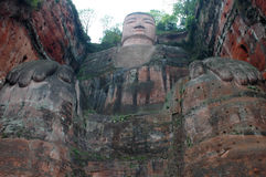 Buddha. Giant Stone sculpture of Buddha in Leshan,Sichuan,China.The Buddha faces Emei Mountain across the river and at its back is the western slope of Lingyun Stock Photos
