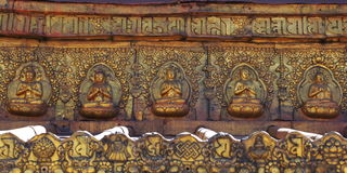 Buddha. Golden Buddha on Tibetan temple wall Stock Image
