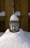 Buddha. Statue covered with snow in the winter garden Stock Images
