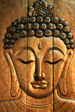 Buddha. A bas-relief in ancient style of Buddha. Handmade Royalty Free Stock Photos
