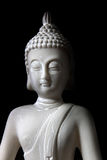 Buddha. White buddha figur - black background Royalty Free Stock Images