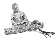 Buddha. Netsuke of Buddha with rosary Stock Images