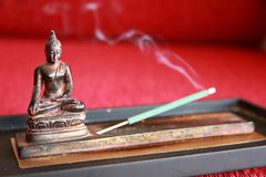 Buddha. Statue with incense stick Stock Photography