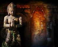 Buddha. A statue of Buddha in front of a sealed doorway in a temple Stock Photography