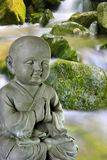 Buddha. Statue in front of a waterfall Stock Images