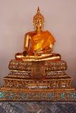 Buddha. A sitting golden buddha statue Royalty Free Stock Photo