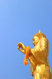 Buddha. Gold color paint Buddha statue with sky background stock photography