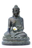 Buddha. With daisy in hand, on white Stock Image