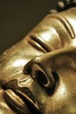 Buddha. Close up of the head of a sleeping buddha stock photo