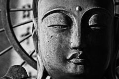 Buddha. Smiling buddha in close-up. Black and white Stock Images
