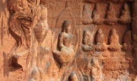 Buddha-Abbildungen geschnitzt im Stein Stockfotografie