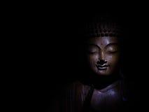 Buddha affronta scuro Fotografie Stock Libere da Diritti