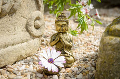 Buddha with altar and flower. Ancient, spiritual style photo with Buddha , altar and flower Royalty Free Stock Photo