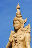 Buddha angel statue in blue sky Royalty Free Stock Images