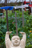 Buddha With Arms Over Head Smiling. A statue of a Buddha with his arms over his head in joy Stock Images