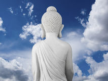 Buddha as seen from behind with cloudscape Stock Photography