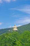 Buddha auf Hügel Stockbild