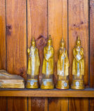 Buddha auf Musterdetail des Teakholzgoldes Lizenzfreies Stockbild