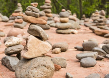 Buddha Beach Rock Cairns. A grouping of small cairns at Buddha Beach near Oak Creek on the Red Rocks Crossing hike in Sedona, AZ royalty free stock image