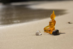 Buddha on a beach stock images